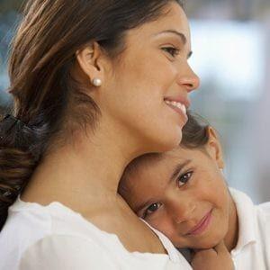 Child Resting Head on Mother's Shoulder