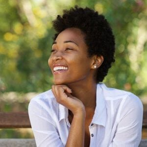 African American Female Smiling and Looking Away