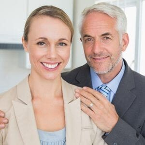 Female and Male Business Partners Smiling