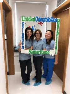Michella Julie and Alejandra with the thank you board the hospital staff made