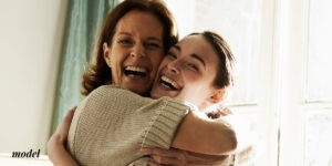 Mother and Daughter hugging and smiling